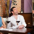 Couple drinking red wine in restaurant — Stock Photo #79227774