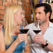 Couple drinking red wine in restaurant — Stock Photo #79227936