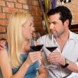 Couple drinking red wine in restaurant — Stock Photo #79227976