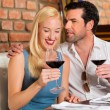 Couple drinking red wine in restaurant — Stock Photo #79227986