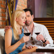 Couple drinking red wine in restaurant — Stock Photo #79227988