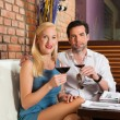 Couple drinking red wine in restaurant — Stock Photo #79228034