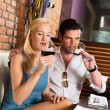 Couple drinking red wine in restaurant — Stock Photo #79228144