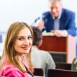College professor giving lecture for students — Stock Photo #79229018