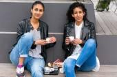 Best friends drinking coffee in city — Stock Photo
