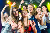 Party people dancing in disco club — Stock Photo