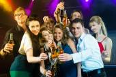 People in club or bar drinking beer — Stock Photo
