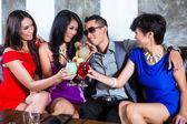 Man flirting with women in nightclub — Stock Photo