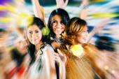 Girls partying on dance floor of disco nightclub — Stock Photo