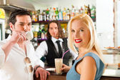 Attractive couple in cafe or coffeeshop — Stock Photo