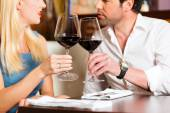 Couple drinking red wine in restaurant — Stock Photo