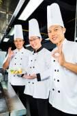 Asian Chefs in hotel restaurant kitchen — Stock Photo