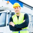 Crane operator in front of truck on site — Stock Photo #79332552