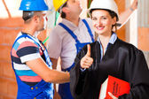 Reviewer or lawyer check building site for defect — Stock Photo