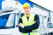 Crane operator in front of truck on site — Stock Photo