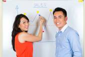 Chinese team in a advertising agency — Stock Photo