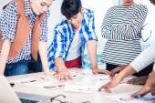 Advertising agency team choosing model for campaign — Stock Photo