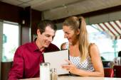 Couple order in a bar or restaurant — Stock Photo