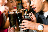 Friends drinking soda in a bar — Stock Photo