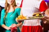People in American diner or restaurant and waitress — Stock Photo