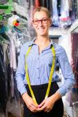 Female cleaner in laundry shop or dry-cleaning — Stock Photo