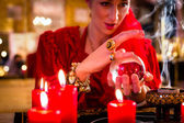 Soothsayer in Seance with Crystal ball and smoke — Stock Photo