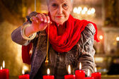 Soothsayer during a Seance or session with pendulum — Stock Photo
