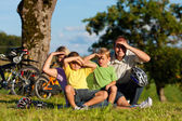 Family on getaway with bikes — Stock Photo