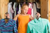 Family - child in front of her closet or wardrobe — Stock Photo