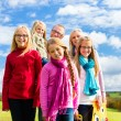 Family walking through the park in fall or autumn — Stock Photo #79441632