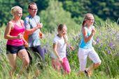 Family running for better fitness in summer — Stock Photo