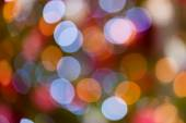 Christmas baubles on tree - Bokeh — Stock Photo