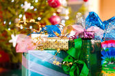Christmas gifts under x-mas tree — Stock Photo