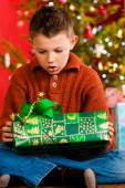 Christmas - little boy with Xmas present — Stock Photo
