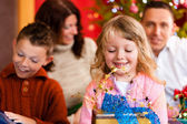Christmas - family with gifts on Xmas Eve — Stock Photo