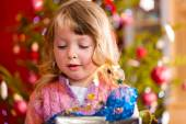 Christmas - little girl with Xmas present — Stock Photo