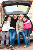 Family on a car trip sitting in the back — Stock Photo