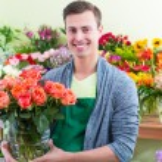 Florist working in flower shop — Stock Photo #79651470