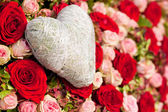 Flowers and heart decoration — Stock Photo