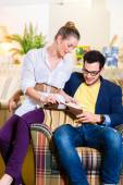Couple picking armchair seat cover in furniture store — Stock Photo