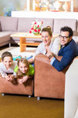 Family buying couch in furniture store — Stock Photo