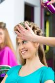 Women at the hairdresser being curled — Stock Photo