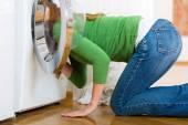 Housekeeper with washing machine — Stock Photo