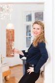 After Hour - woman at home with sparkling wine — Stock Photo