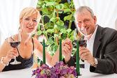 Senior couple eating dinner in restaurant — Stock Photo