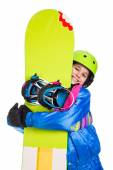Smiling girl with snowboard — Stock Photo