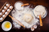 Baking ingredients on dark table — Stok fotoğraf