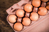 Chicken eggs in carton tray — Stok fotoğraf