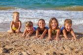 Five kids on the beach — Stock Photo