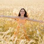 Happy girl on wheat field — Stock Photo #74796443